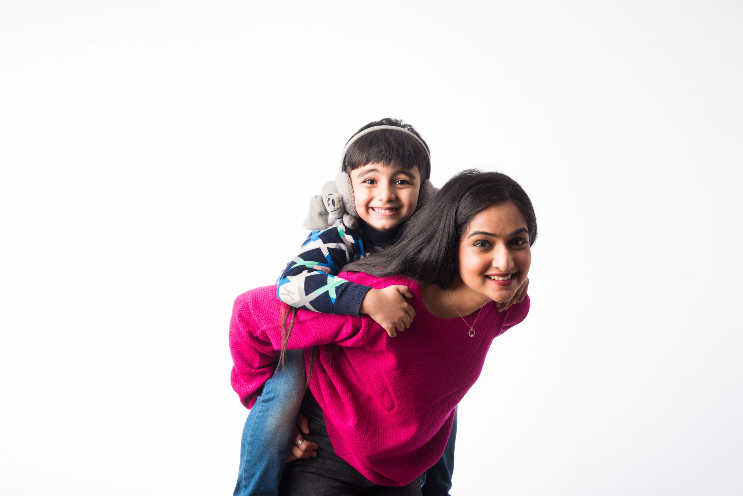 Indian pretty mother with son wears winter clothes or sweater against white background
